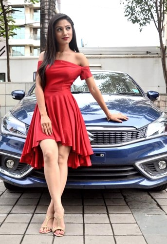 Donal Bisht with her car