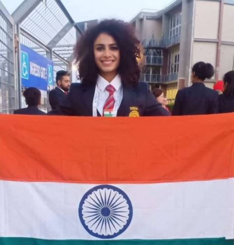 Harmilan with the flag at the World University Games 2019 at Napoli in Italy