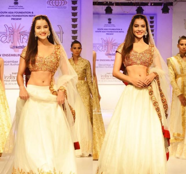 Shristi while walking on the ramp at a fashion show