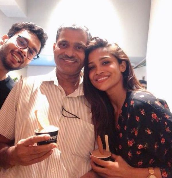 Sushrii with her father and brother