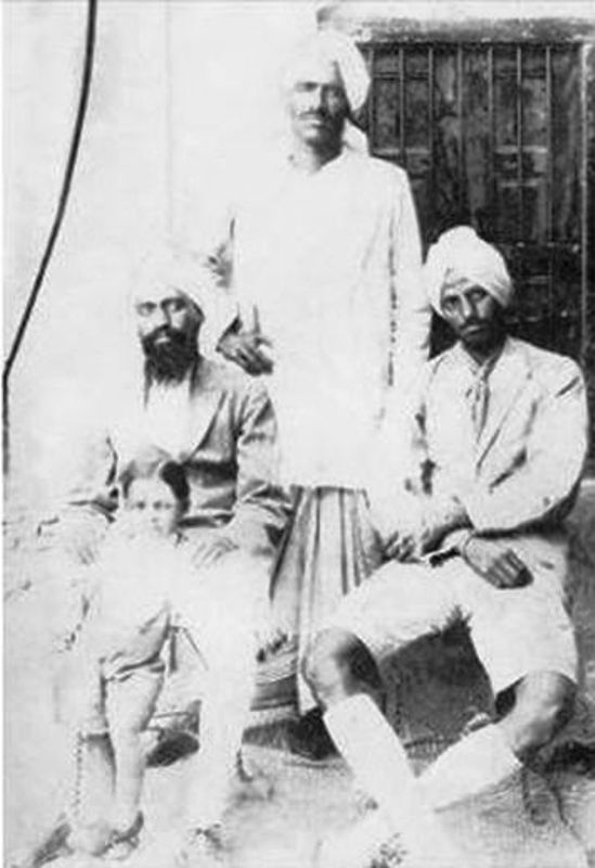 Udham Singh (standing) with his friends