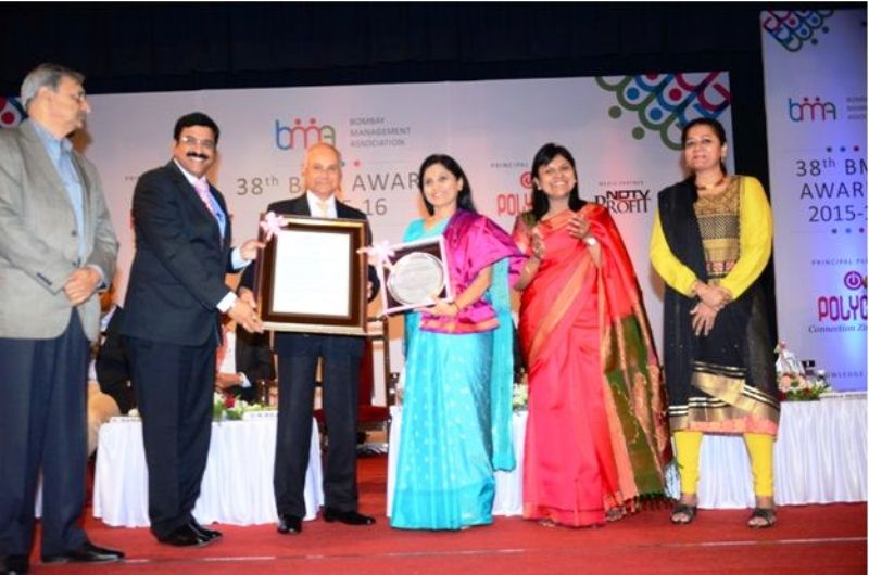 Usha Sangwan receiving the BMA Management Woman Achiever of the Year Award